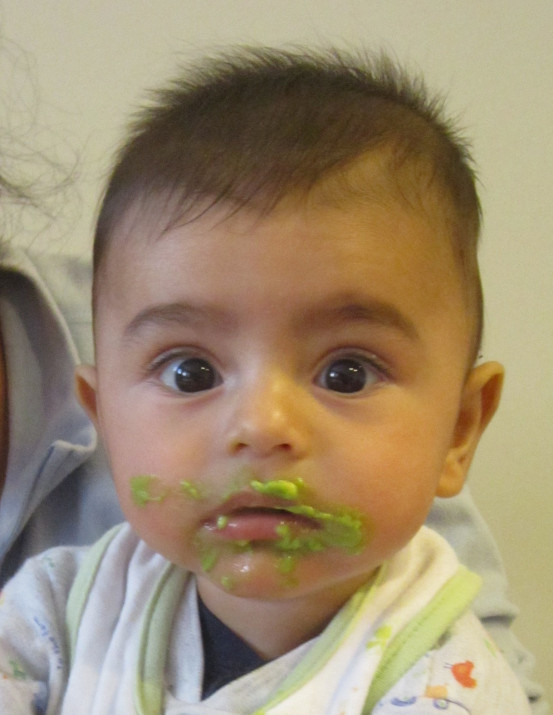 Ayhan trying mashed peas for the first time.